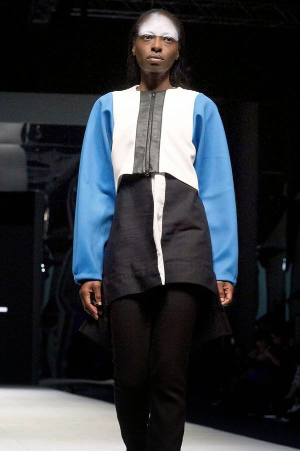 A model presents a creation by South African fashion designer Alexandra Blanc, on July 25, 2014 during the fashion week at the Cape Town International Convention Centre, in Cape Town, South Africa.