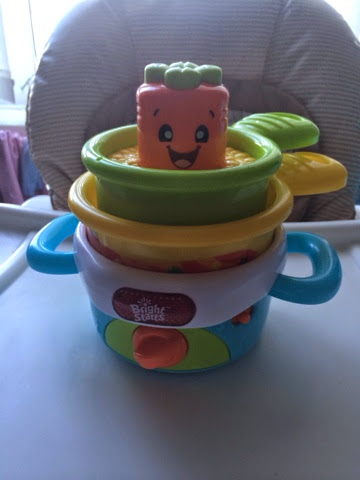 Nest n sing pot toy stacked up