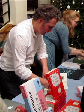 Ben Goldacre signing copies of his books