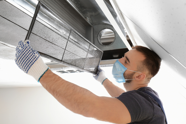 hvac technician cleaning filter