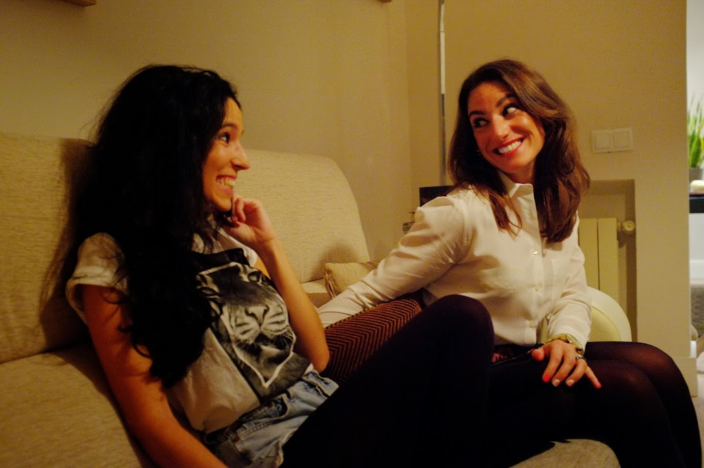 smiling girls in sofa