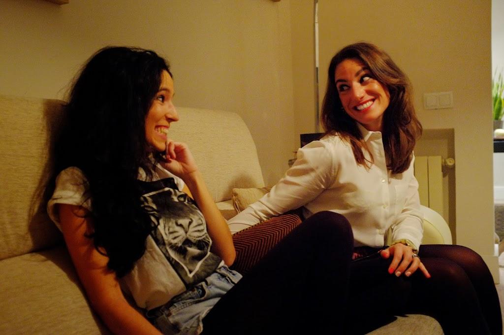 smiling girls in sofa