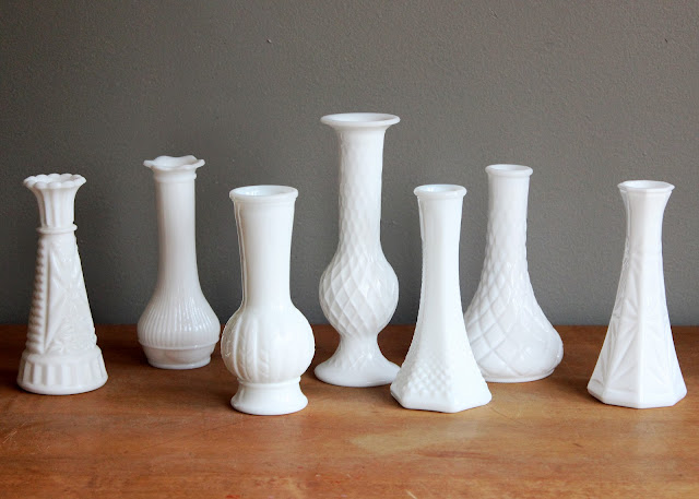 Milk glass bud vases available for rent from www.momentarilyyours.com, $0.75 each.