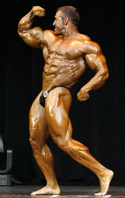 Sexy Competitive Male Bodybuilder Posing on Stage