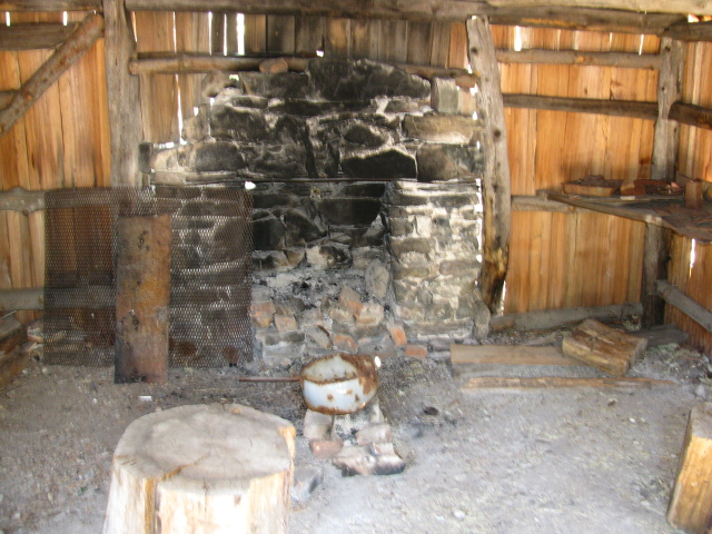 fireplace and other elements of the inside of the cabin