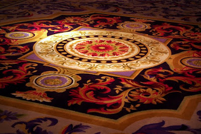 Colorful rug in the ballroom of the Corinthia Hotel in London