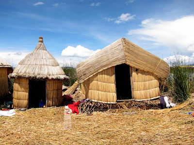 Homes on the floating islands in Lake Titicaca near Puno Peru