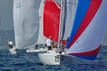 J/105 one-design sailboats- sailing under spinnakers