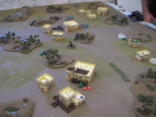 Iron Warriors and Space Wolves continue to fight over an Ork settlement.