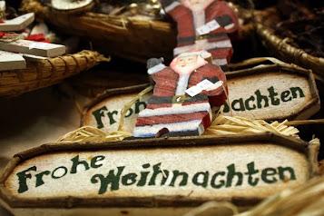 Santas for sale at a Salzburg Christmas market in Austria