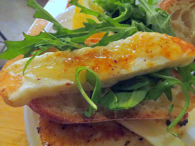 Cheese & Crack Snack Special of Grilled Halloumi with seared halloumi cheese, toast, honey, lemon and greens.