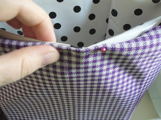 7.  Turn the top edges of the bag under by finger pressing. Pin in place.