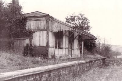 Toller station stands derelict and abandonded beside the trackbed of the Maiden Newton to Bridport branch which closed in the winter of 1980. It had been disused since staff were withdrawn in April 1966. Date ?  Photo: Les Hawkins. (B123)