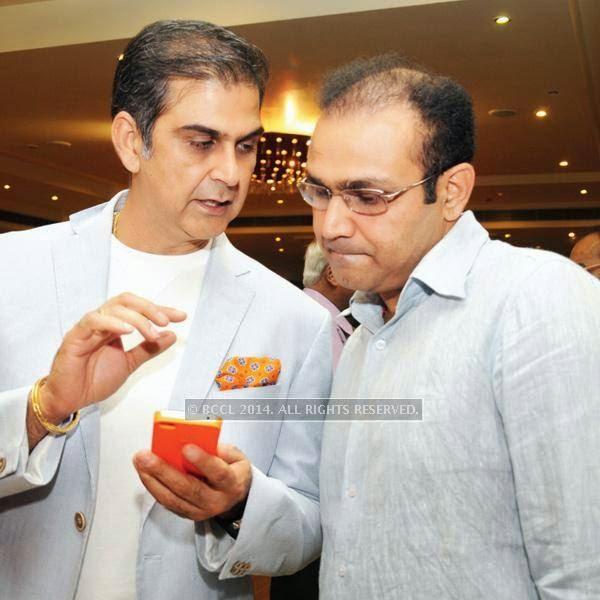 Nikhil Chopra (L) and Virender Sehwag during the 25th wedding anniversary Saba Karim and Rashmi, held in Delhi.