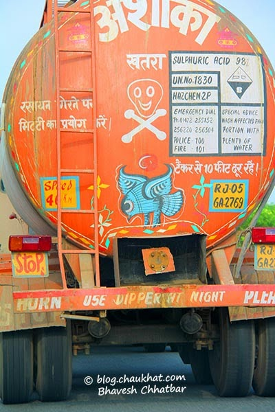 Truck slogans in India - Danger - Sulphuric acid - Keep 10 feet away from truck