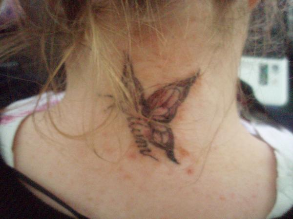 neck butterfly tatoos