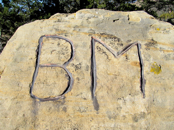Large 'B.M.' on a boulder along Little Park Road