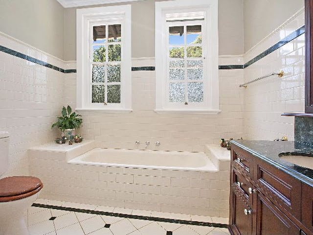 Largely original floor and wall tiling and marble top handbasin unit