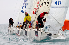 J/24s round windward mark- sailing Trofeo Academmia Navale