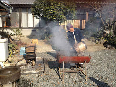 Mr.Awata pouring coals into the grill