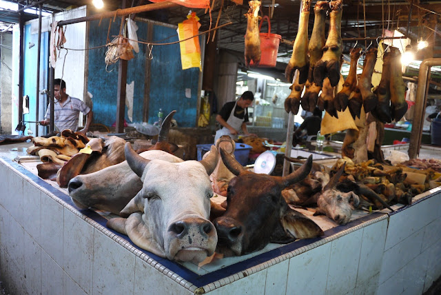 cow and goat heads at Bazaar Baru Chow Kit in Kuala Lumpur, Malaysia