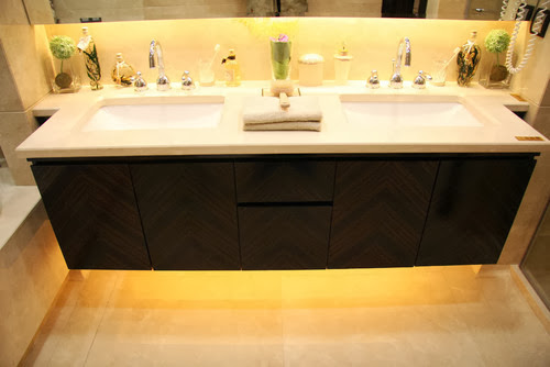 Strip Lights Are Tucked Under The Bathroom Vanity Mirror To Illuminate Countertop