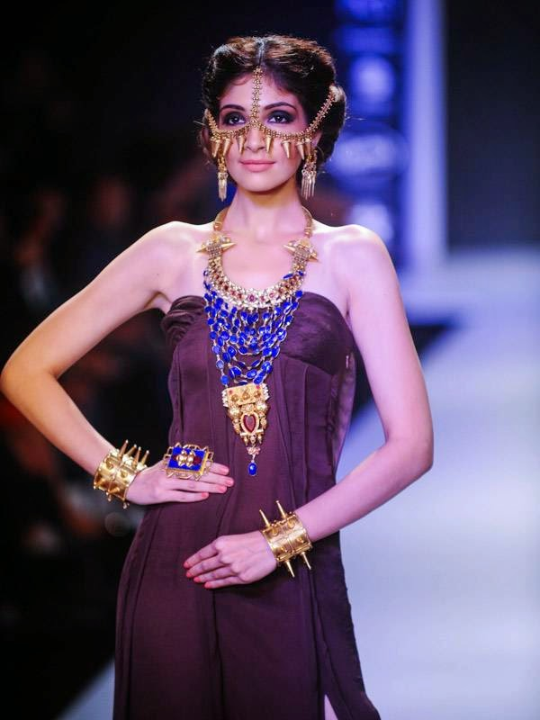 A model showcases a design by Apala by Sumit on Day 1 of India International Jewellery Week (IIJW), 2014 at Grand Hyatt, Mumbai.