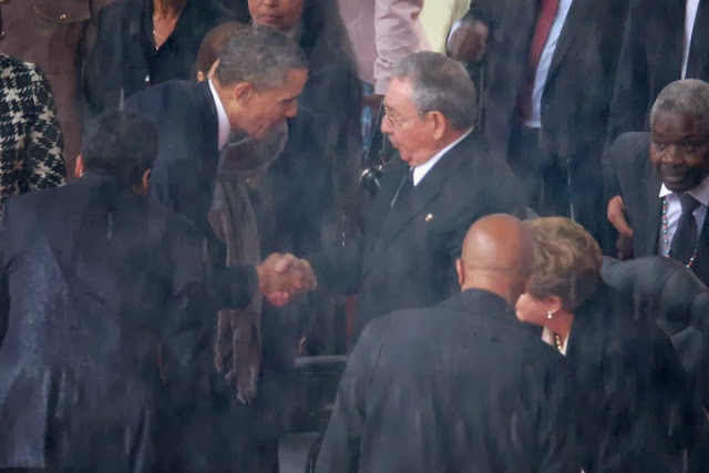 Obama eulogizes Mandela and bows to Castro