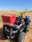 ATV loaded with raft and rappelling gear