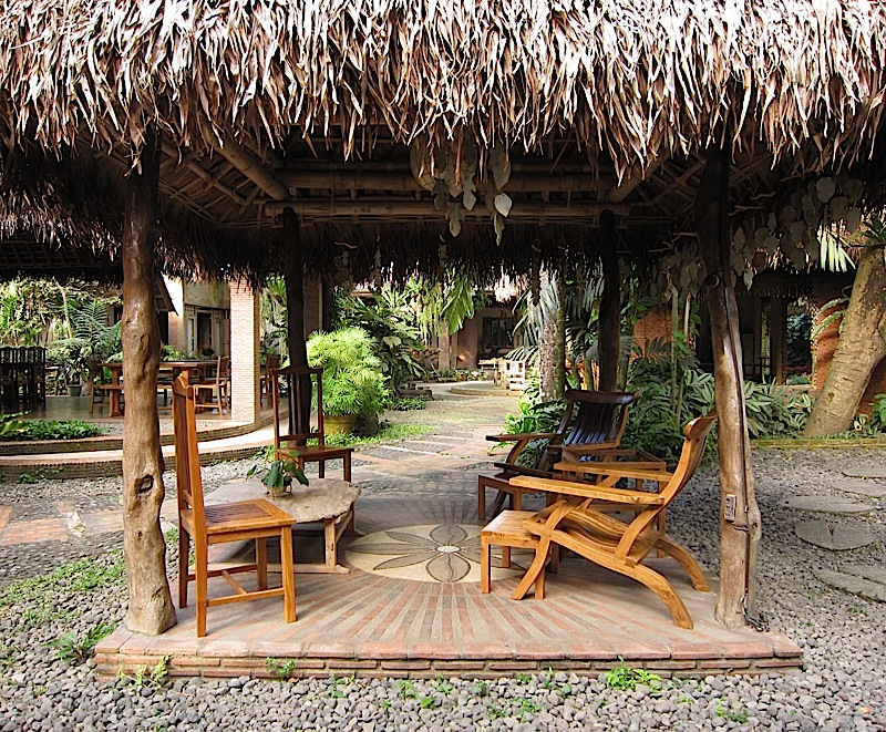 small nipa hut with lounge chairs at Ugu Bigyan Potter's Garden