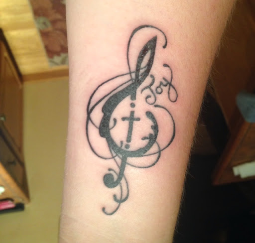 52 best cross tattoos designs and ideas rh tattoosme com music note cross tattoo Meaning of Music Note Tattoos