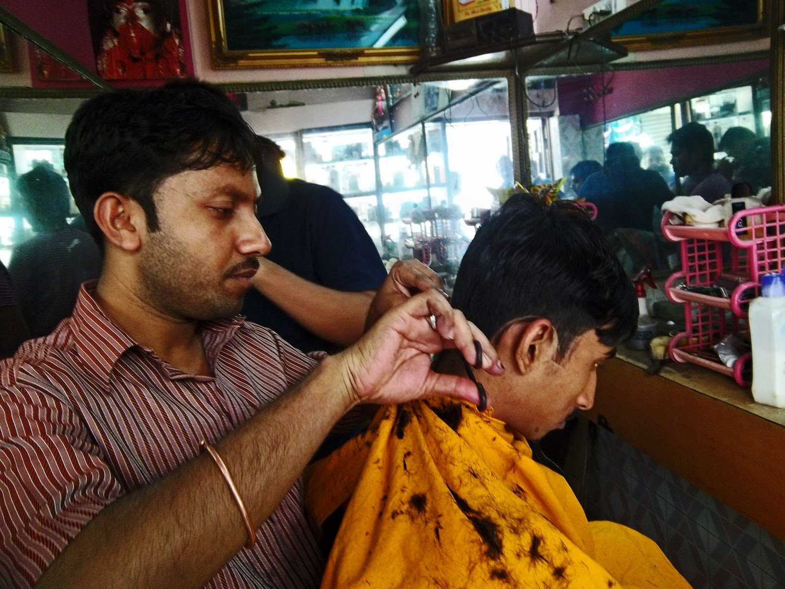 Stock Pictures: Indian Hair stylists at work in small salons