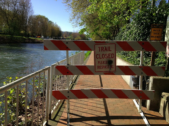 High water this afternoon closes the Cedar River Trail, downtown Renton, Washington.