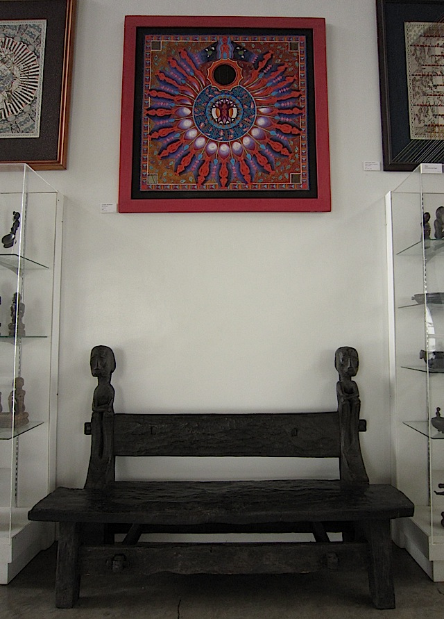 Ifugao bench with bulol and Leonard Aguinaldo's Bulol Mandala at the BenCab Museum