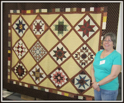 Lynn Nelson from Elkhart won the Civil War Stars raffle quilt