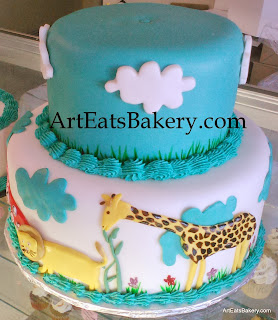 First birthday cake with flowers, pink elephant, red hippo, lion and girrafe