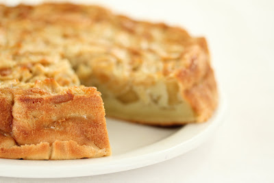 close-up photo of an apple cake with a slice removed