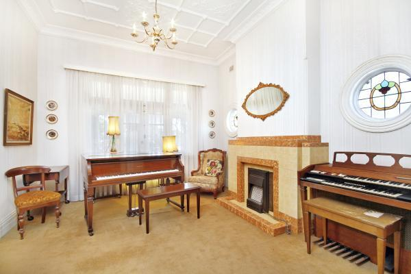 Haberfield Bull's eye window illuminates a music room