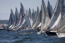 J/24 one-design sailboats- sailing to starting line