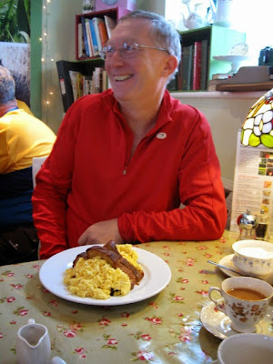 man with large plate of scrambled eggs