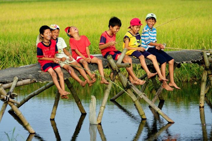 Vietnam children fishing at a small cannel