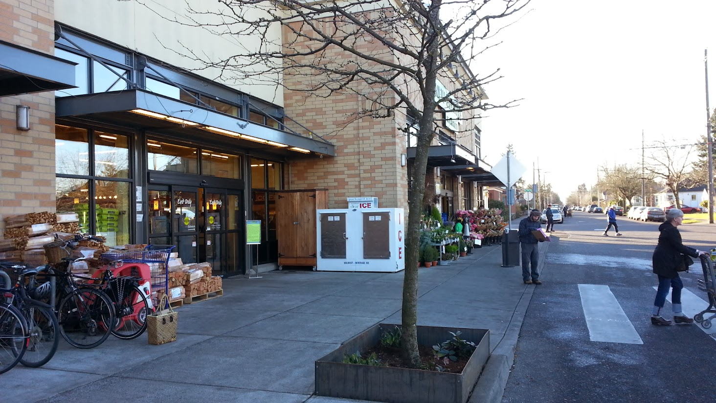 the front of New Seasons Market in Northeast Portland, with bikes and pedestrians