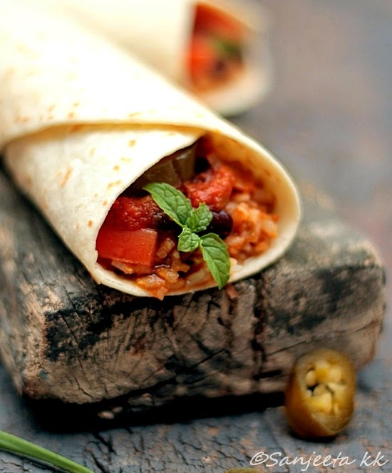 vegetarian burritos or katti roll with brown rice and kidney beans.