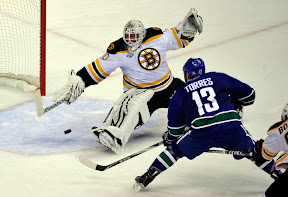 Canucks Raffi Torres scores the game winning goal against Bruins Tim Thomas