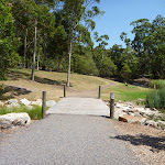 Timber bridge over creek in Richley Reserve in Blackbutt Reserve (401584)
