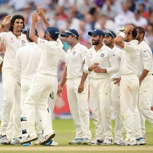 India's Ishant Sharma (2nd L) is congratulated after dismissing England's Ian Bell during the second cricket test match at Lord's cricket ground in London July 20, 2014.