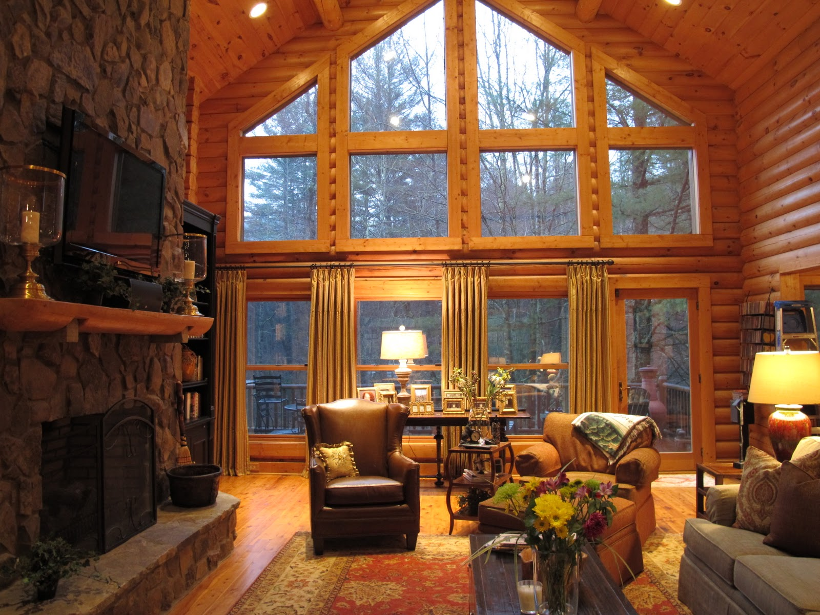 The side panels help soften the large log cabin living room