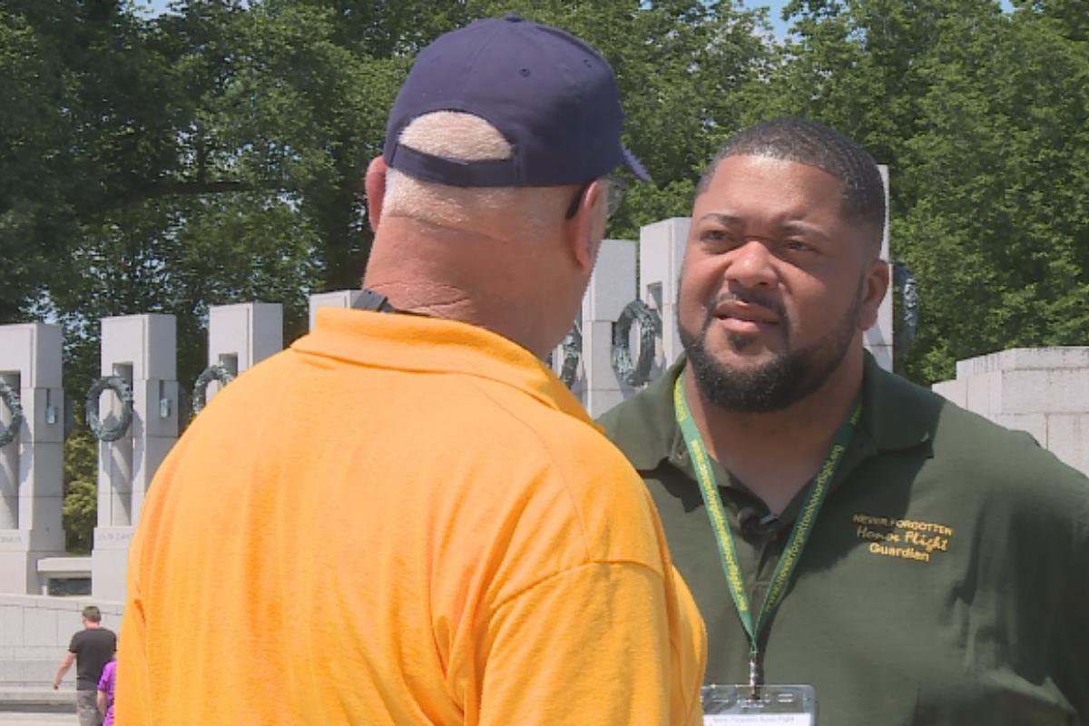 Gilbert Brown talking with veteran