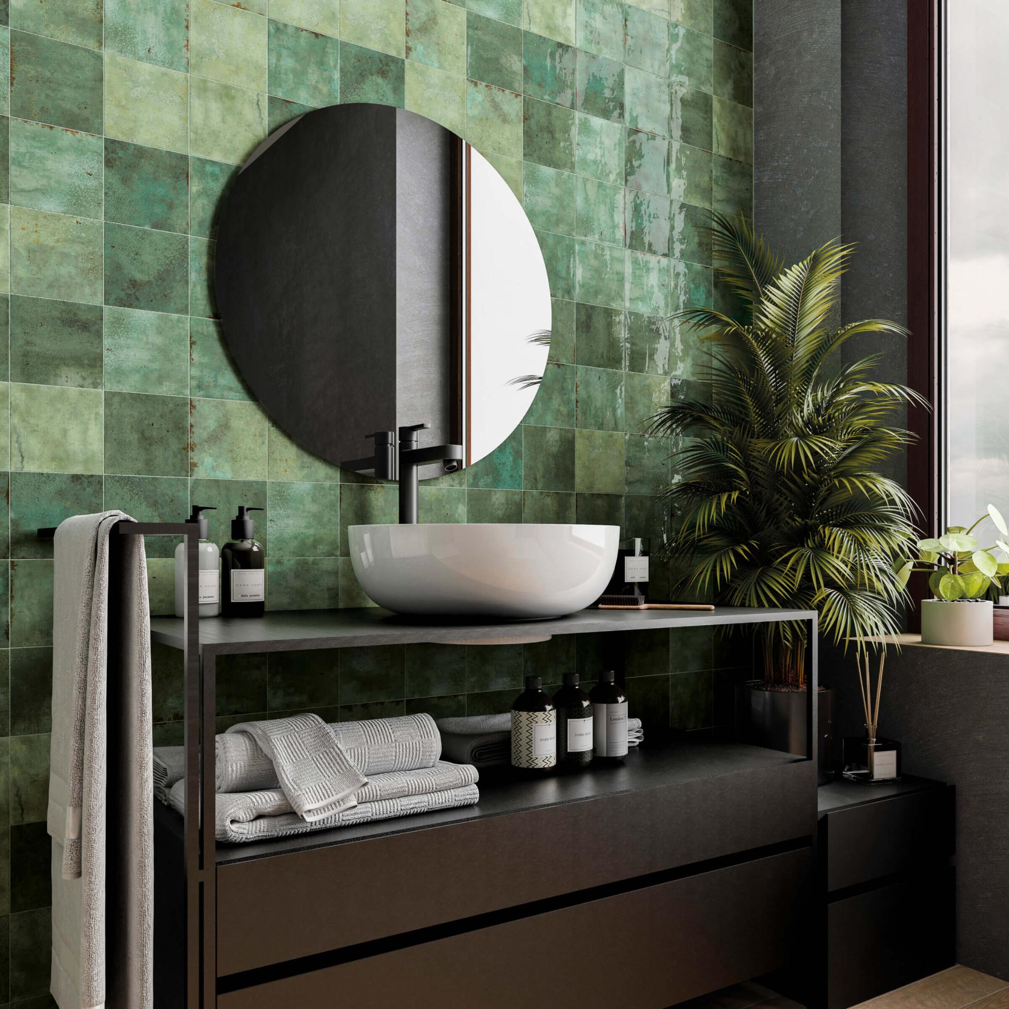 Bathroom with variegated green tile backsplash