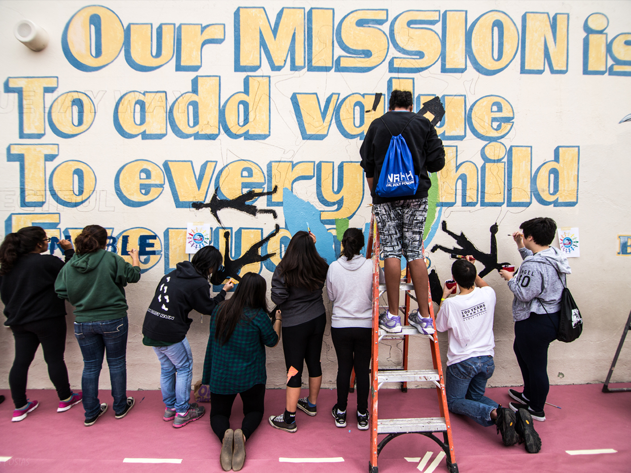 Image of volunteers painting a mural